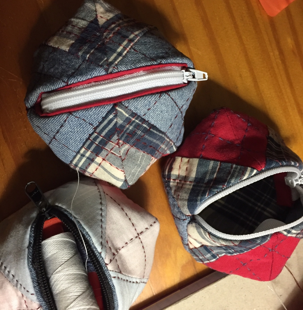 Three little patchwork coin pouches, light blue and pink; red, blue plaid and denim; denim and blue plaid